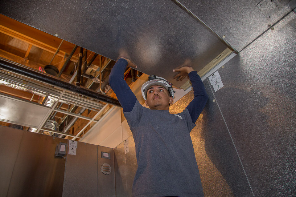 Adding a ceiling panel to the Walk-In Cooler Installation