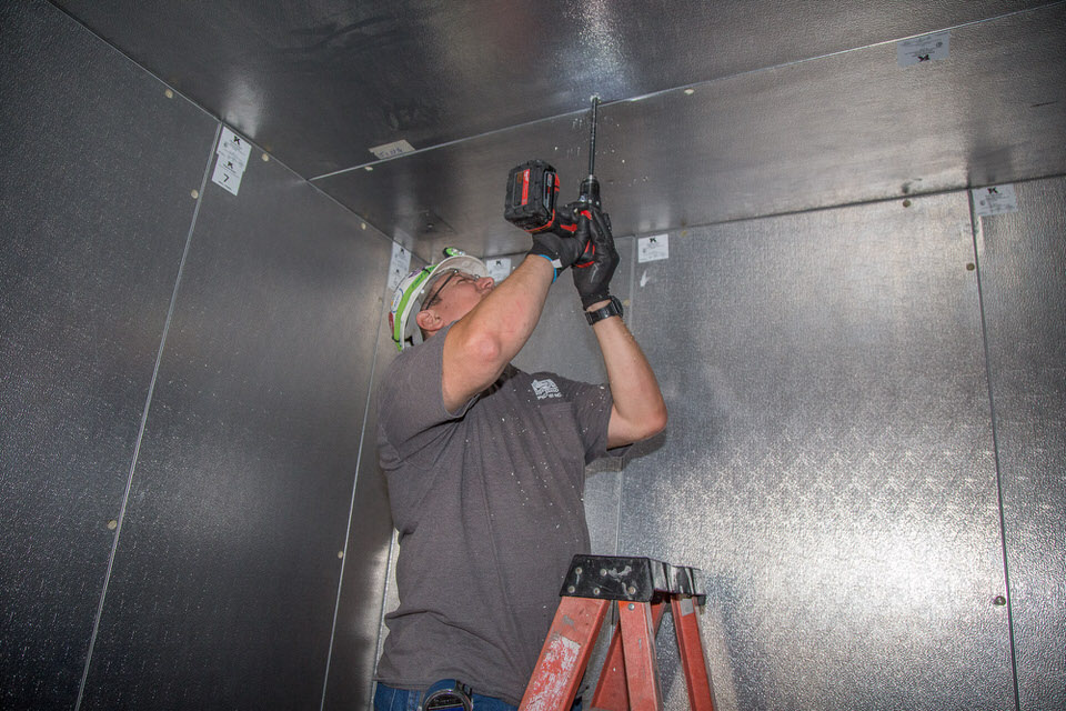 drilling the evaporator holes for the Walk-in Cooler Installation