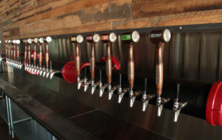 The custom 40 Tap Micro Matic Tower mounted to the wall
